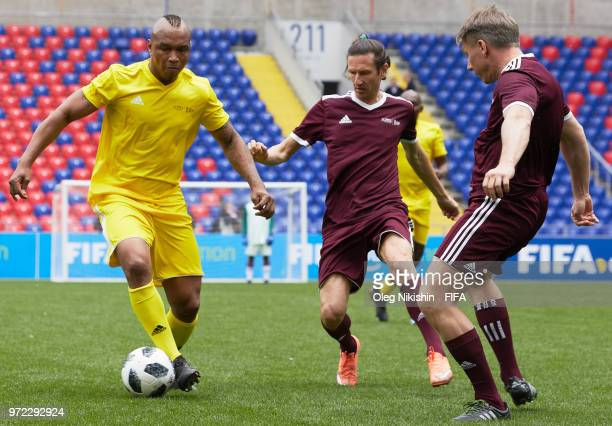 Kalusha Bwalya of CAF vies for the ball with Alexey Smertin and Alexey Sorokin of Russian FA during FIFA Congress Delegation Football Tournament at...