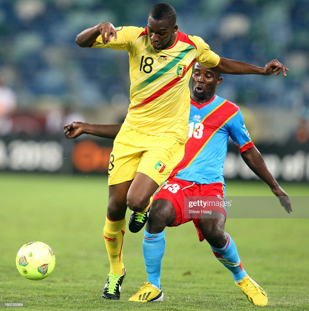 Kaluyituka Dioko of DR Congo with a tackle on Samba Sow of Mali during the 2013 African Cup of Nations match between Congo DR and Mali at Moses Mahbida Stadium on January 28, 2013 in Durban, South Africa.