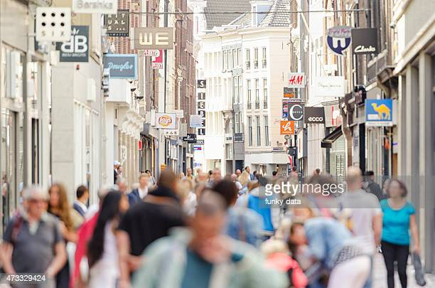 kalverstraat shopping street amsterdam city center - high street stock pictures, royalty-free photos & images