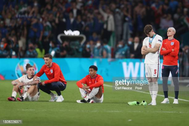 Kalvin Phillips, Ben White, Jude Bellingham, John Stones and Phil Foden of England look dejected following defeat in the UEFA Euro 2020 Championship...