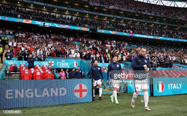 Kalvin Phillips, Mason Mount and Luke Shaw of England make their way towards the pitch prior to the UEFA Euro 2020 Championship Final between Italy...