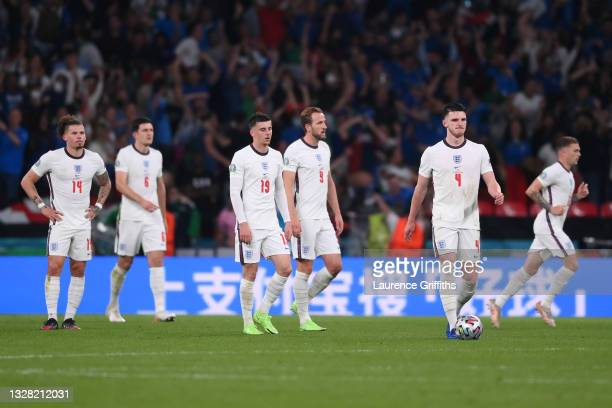 Kalvin Phillips, Mason Mount, Harry Kane and Declan Rice of England look dejected after the Italy first goal scored by Leonardo Bonucci during the...