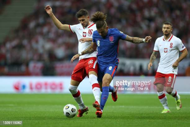 Kalvin Phillips of England battles for possession with Jakub Moder of Poland during the 2022 FIFA World Cup Qualifier match between Poland and...