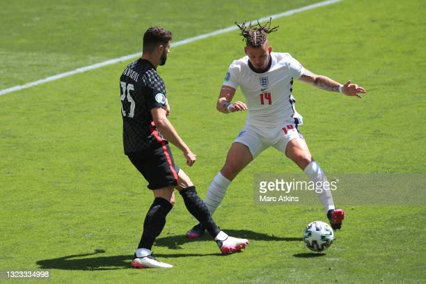 Kalvin Phillips of England is challenged by Josko Gvardiol of Croatia during the UEFA Euro 2020 Championship Group D match between England and...