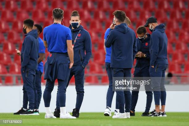 Kalvin Phillips of England speaks with team mates during pitch inspections prior to the UEFA Nations League group stage match between Denmark and...