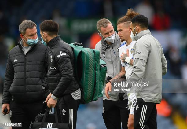 Kalvin Phillips of Leeds is helped off the field by medics after picking up an injury during the Premier League match between Leeds United and West...