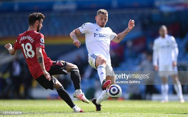Kalvin Phillips of Leeds United and Bruno Fernandes of Manchester United battle for possession during the Premier League match between Leeds United...