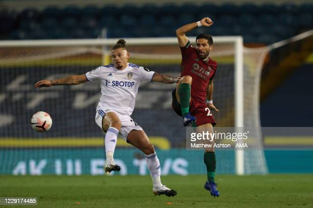 Kalvin Phillips of Leeds United and Joao Moutinho of Wolverhampton Wanderers during the Premier League match between Leeds United and Wolverhampton...