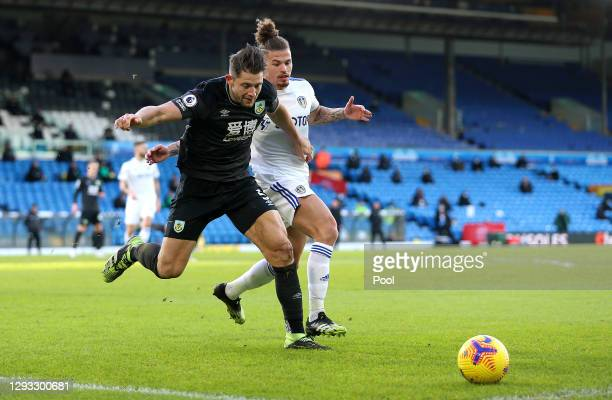 Kalvin Phillips of Leeds United battles for possession with James Tarkowski of Burnley during the Premier League match between Leeds United and...
