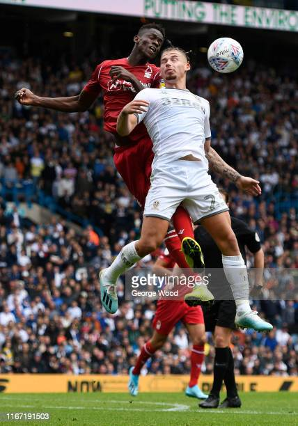 Kalvin Phillips of Leeds United battles for the ball with Alfa Semedo of Nottingham Forest during the Sky Bet Championship match between Leeds United...