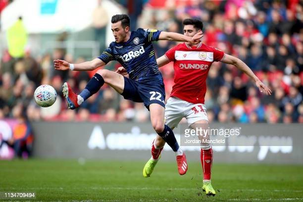 Kalvin Phillips of Leeds United controls the ball in the air under pressure from Callum O'Dowda of Bristol City during the Sky Bet Championship...
