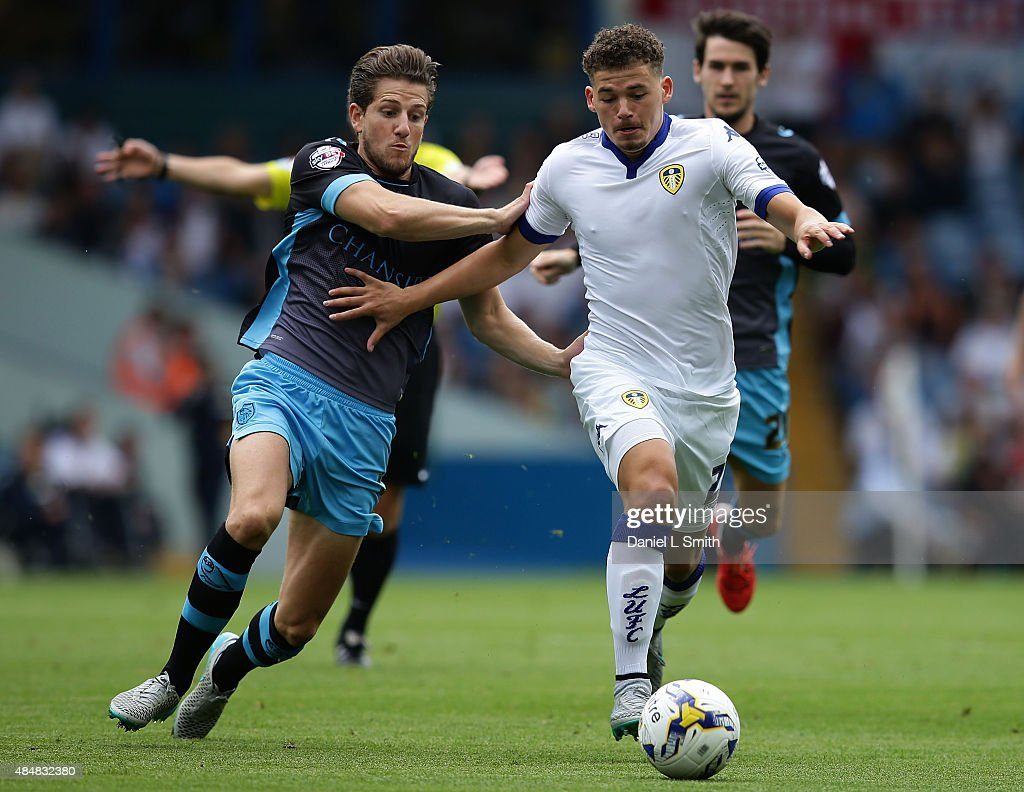 Kalvin Phillips of Leeds United FC olds off Sam Hutchinson of Sheffield Wednesday FC during the Sky Bet Championship match between Leeds United and Sheffield Wednesday at Elland Road on August 22, 2015 in Leeds, England.