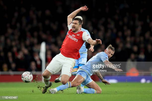 Kalvin Phillips of Leeds United in action with Sokratis Papastathopoulos of Arsenal during the FA Cup Third Round match between Arsenal and Leeds...
