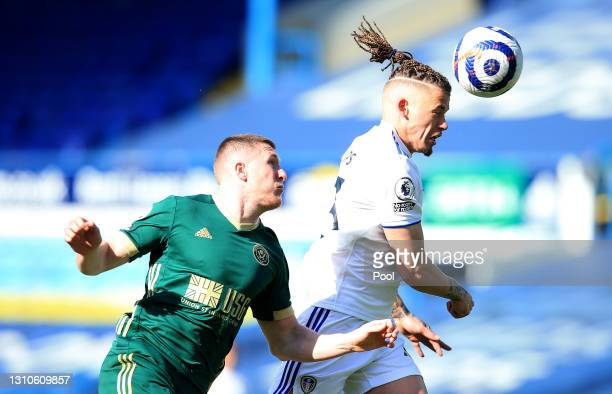 Kalvin Phillips of Leeds United is challenged by John Lundstram of Sheffield United during the Premier League match between Leeds United and...