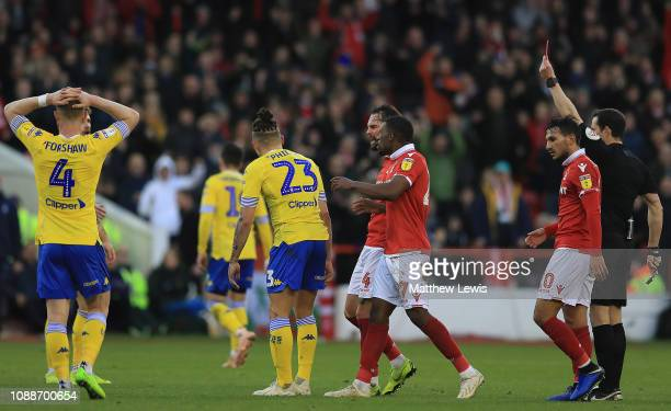 Kalvin Phillips of Leeds United is given a red card by referee Darren England after his challenge on Adlene Guedioura of Nottingham Forest during the...