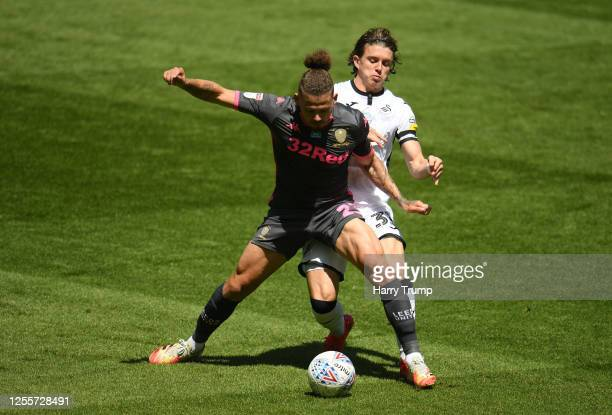 Kalvin Phillips of Leeds United is tackled by Conor Gallagher of Swansea City during the Sky Bet Championship match between Swansea City and Leeds...