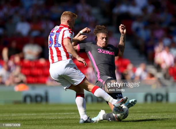 Kalvin Phillips of Leeds United slides in to tackle Mark Duffy of Stoke City during the Sky Bet Championship match between Stoke City and Leeds...