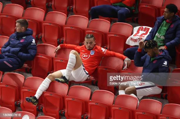 Kalvin Phillips, Reece James and Jude Bellingham of England look on from the bench during the FIFA World Cup 2022 Qatar qualifying match between...