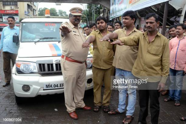 Kalyan RTO chief Sanjay Sasane visits an auto stand at Dombivli station motivates them to take an oath towards following all the norms while plying...
