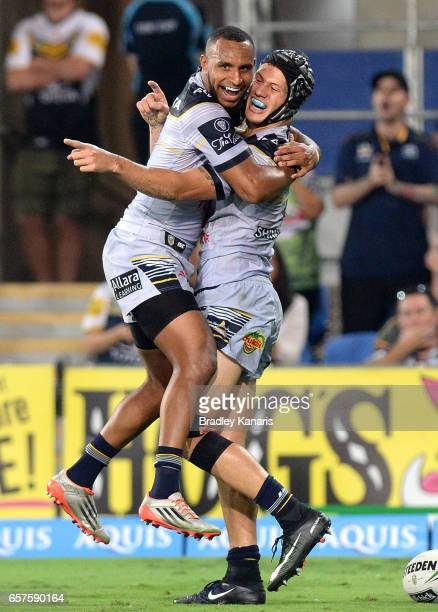 Kalyn Ponga celebrates with Gideon GelaMosby of the Cowboys after scoring a try during the round four NRL match between the Gold Coast Titans and the...