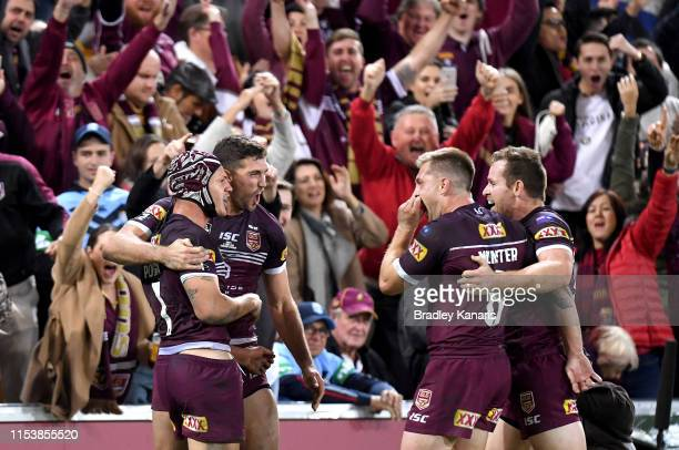 Kalyn Ponga Corey Oates Cameron Munster and Michael Morgan of the Maroons celebrate victory after game one of the 2019 State of Origin series between...