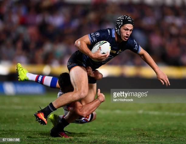 Kalyn Ponga of the Cowboys is tackled by Brock Lamb of the Knights during the round eight NRL match between the North Queensland Cowboys and the...