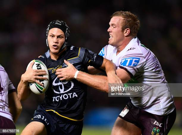 Kalyn Ponga of the Cowboys is tackled by Jake Trbojevic of the Sea Eagles during the round three NRL match between the North Queensland Cowboys and...
