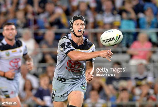 Kalyn Ponga of the Cowboys passes the ball during the round four NRL match between the Gold Coast Titans and the North Queensland Cowboys at Cbus...