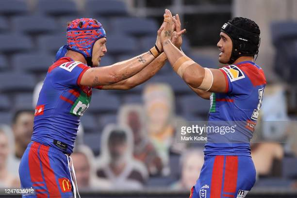 Kalyn Ponga of the Knights celebrates with team mates after scoring a try during the round four NRL match between the Canberra Raiders and the...
