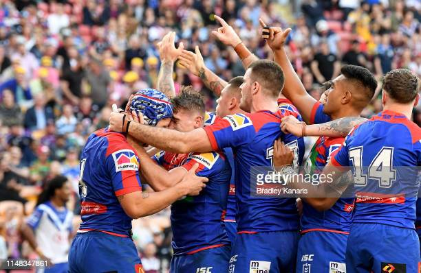 Kalyn Ponga of the Knights is congratulated by team mates after scoring a try during the round nine NRL match between the Canterbury Bulldogs and the...