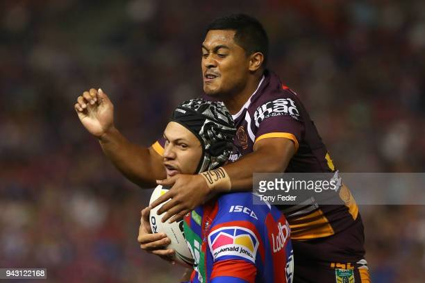 Kalyn Ponga of the Knights is tackled by Anthony Milford of the Broncos during the round five NRL match between the Newcastle Knights and the...