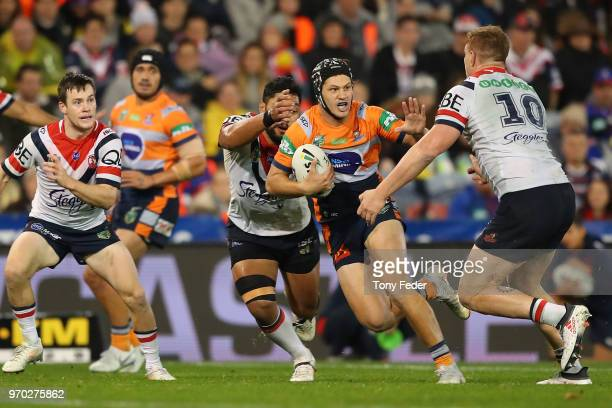 Kalyn Ponga of the Knights is tackled during the round 14 NRL match between the Newcastle Knights and the Sydney Roosters at McDonald Jones Stadium...