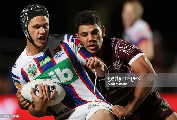 Kalyn Ponga of the Knights is tackled during the Round eight NRL match between the ManlyWarringah Sea Eagles and the Newcastle Knights at Lottoland...