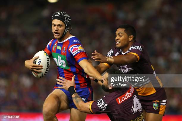 Kalyn Ponga of the Knights is tackled during the round five NRL match between the Newcastle Knights and the Brisbane Broncos at McDonald Jones...