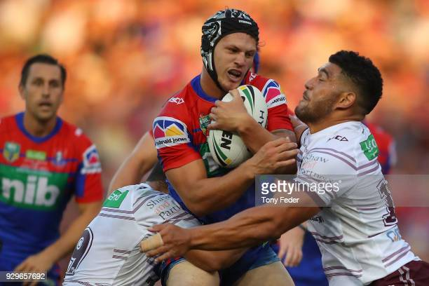 Kalyn Ponga of the Knights is tackled during the round one NRL match between the Newcastle Knights and the Manly Sea Eagles at McDonald Jones Stadium...