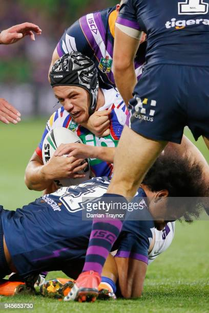 Kalyn Ponga of the Knights is tackled during the round six NRL match between the Melbourne Storm and the Newcastle Knights at AAMI Park on April 13...