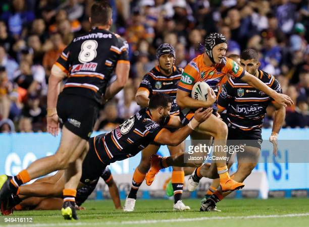 Kalyn Ponga of the Knights makes a break during the round seven NRL match between the Wests Tigers and the Newcastle Knights at Scully Park on April...