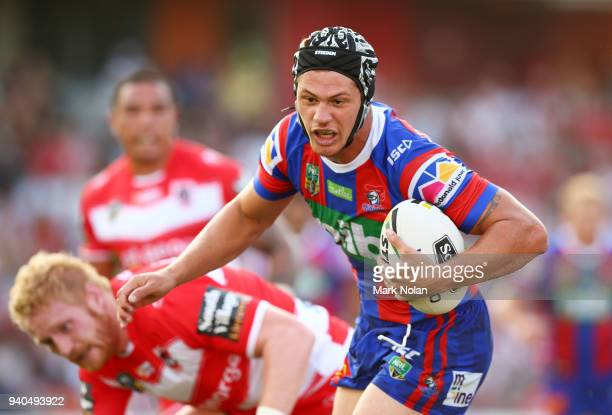 Kalyn Ponga of the Knights runs the ball during the round four NRL match between the St George Illawarra Dragons and the Newcastle Knights at WIN...