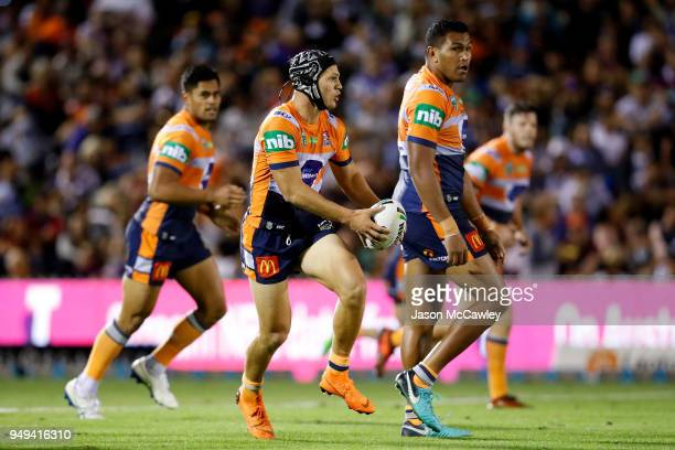 Kalyn Ponga of the Knights runs the ball during the round seven NRL match between the Wests Tigers and the Newcastle Knights at Scully Park on April...