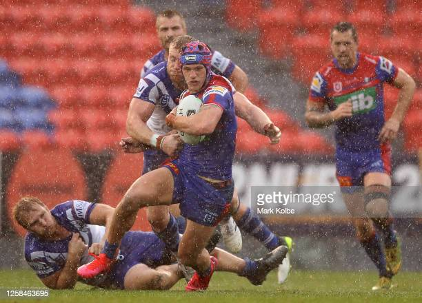 Kalyn Ponga of the Knights runs with the ball during the round 11 NRL match between the Newcastle Knights and the Canterbury Bulldogs at McDonald...