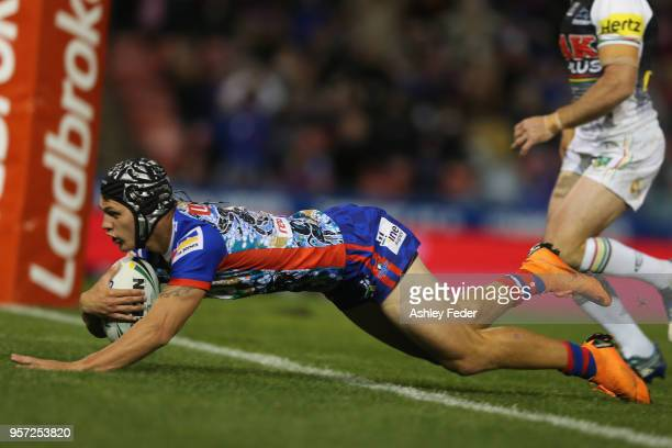 Kalyn Ponga of the Knights scores a try during the round 10 NRL match between the Newcastle Knights and the Penrith Panthers at McDonald Jones...