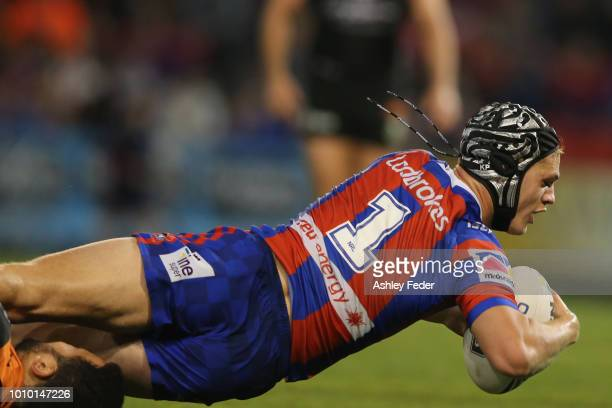 Kalyn Ponga of the Knights scores a try during the round 21 NRL match between the Newcastle Knights and the Wests Tigers at McDonald Jones Stadium on...