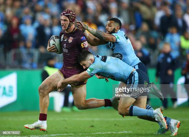 Kalyn Ponga of the Maroons runs the ball during game two of the State of Origin series between the New South Wales Blues and the Queensland Maroons...