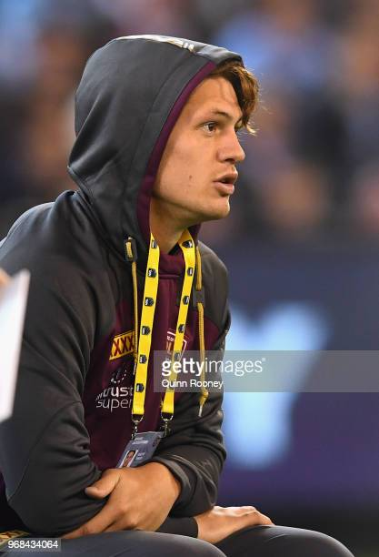 Kalyn Ponga of the Maroons watches on from the sidelines during game one of the State Of Origin series between the Queensland Maroons and the New...