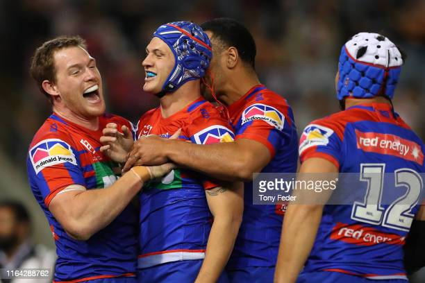 Kalyn Ponga of the Newcastle Knights celebrates a try with team mates during the round 19 NRL match between the Newcastle Knights and Wests Tigers at...