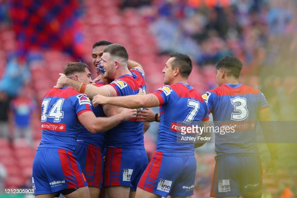 Kalyn Ponga of the Newcastle Knights celebrates his try with team mates during the round 1 NRL match between the Newcastle Knights and the New...