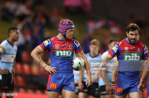 Kalyn Ponga of the Newcastle Knights scores a try and is surrounded by team mates during the round 17 NRL match between the Newcastle Knights and the...