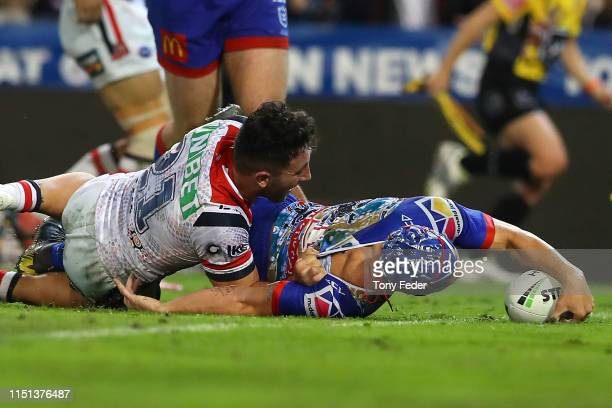 Kalyn Ponga of the Newcastle Knights scores a try during the round 11 NRL match between the Newcastle Knights and the Sydney Roosters at McDonald...