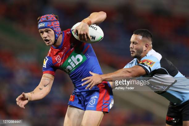 Kalyn Ponga of the Newcastle Knights scores a try during the round 17 NRL match between the Newcastle Knights and the Cronulla Sharks at McDonald...