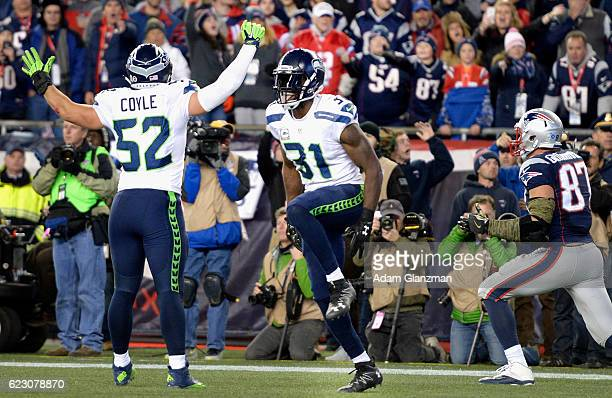 Kam Chancellor and Brock Coyle of the Seattle Seahawks react during the fourth quarter of a game against the New England Patriots at Gillette Stadium...